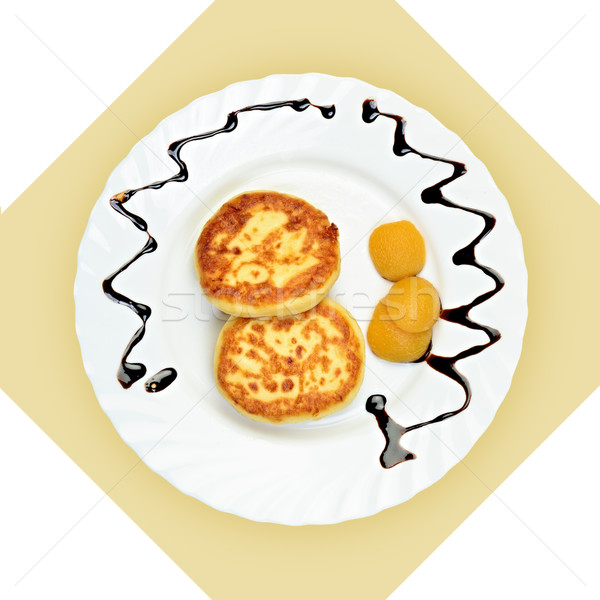 Dish of pancakes with dried apricot on white plate. Stock photo © Pilgrimego