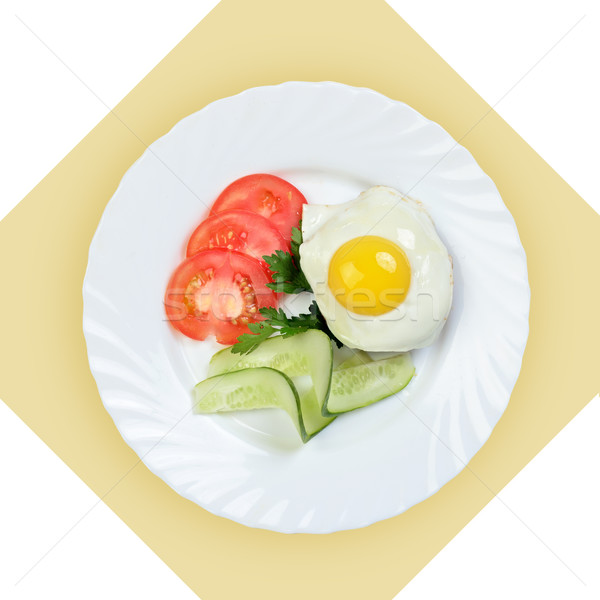 Dish of scrambled egg with vegetables on white plate. Stock photo © Pilgrimego