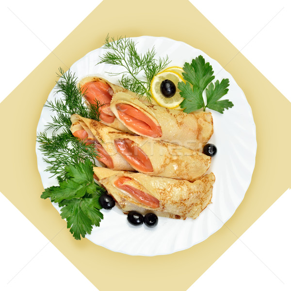 Salmon rolls in crepes with greens on white plate. Stock photo © Pilgrimego