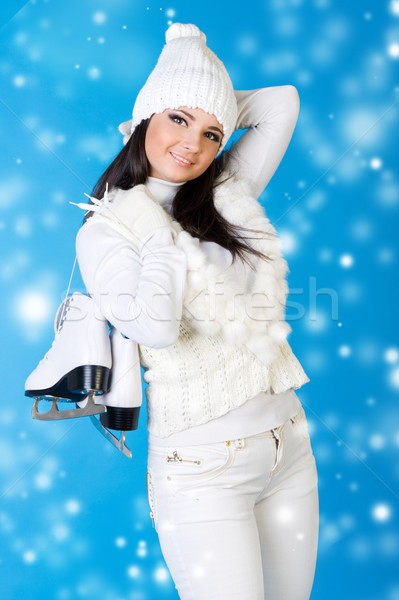 Beautiful woman in winter clothes with skates.  Stock photo © Pilgrimego