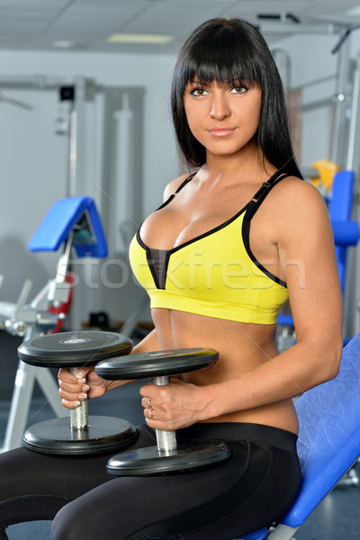 Beautiful woman doing exercises in the sport club. Stock photo © Pilgrimego