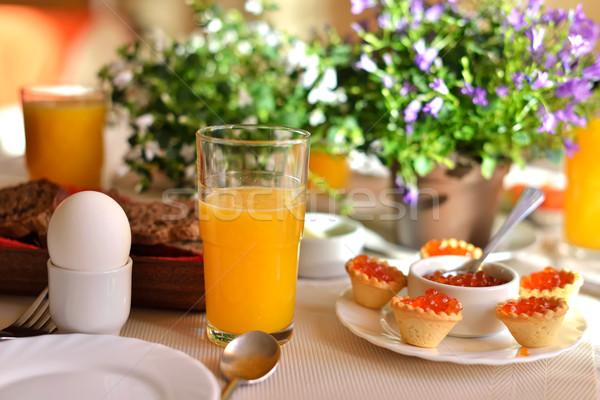 Colazione continentale rosso caviale uovo succo d'arancia Foto d'archivio © Pilgrimego