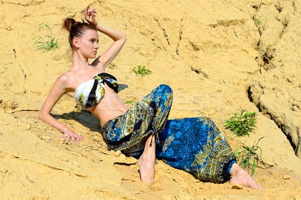 Gyönyörű nő ül homok kint égbolt természet Stock fotó © Pilgrimego