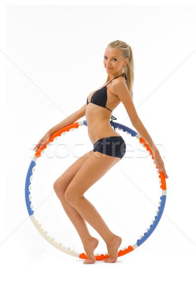 woman is doing gym exercises with hoop Stock photo © Pilgrimego