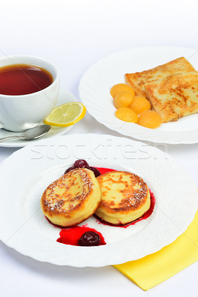 Food of Crepes, cheesecakes with berry sause and cup of tee. Stock photo © Pilgrimego