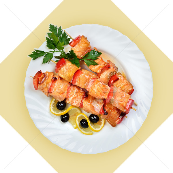 Dish of salmon fish on skewer on white plate. Stock photo © Pilgrimego