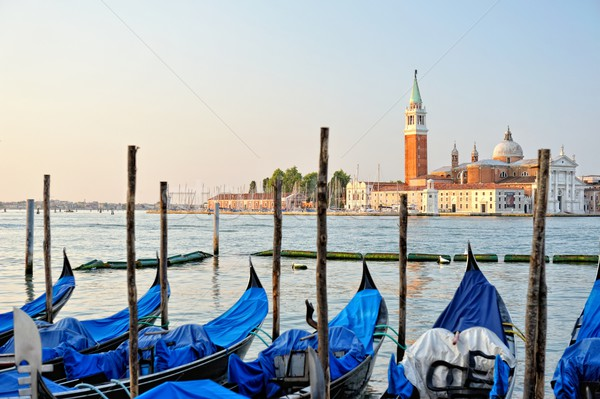 Stock photo: View to the gondolas and boats berth  in Venice.