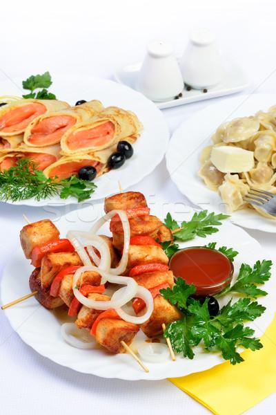 Fehér asztal étel hús lazac tekercsek Stock fotó © Pilgrimego