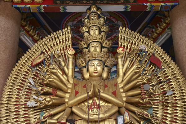 Dourado mil mãos asiático paz estátua Foto stock © pinkblue