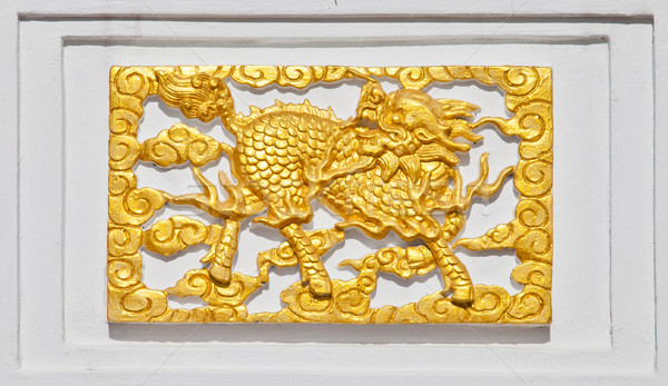 Golden Dragon on temple wall Stock photo © pinkblue