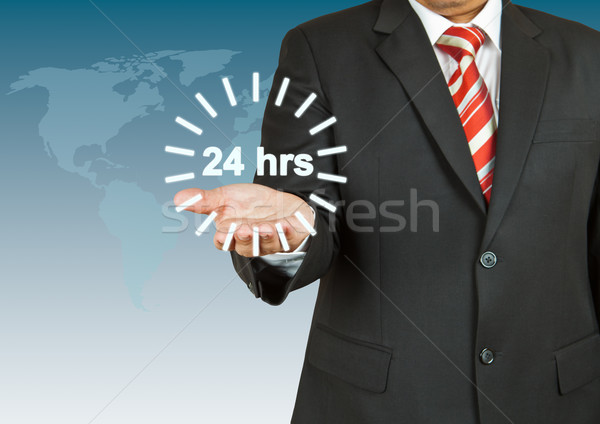 Stock photo: Businessman with 24 hour circle