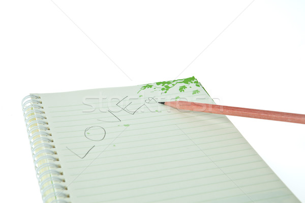 Pencil and notebook with LOVE isolated on white background Stock photo © pinkblue