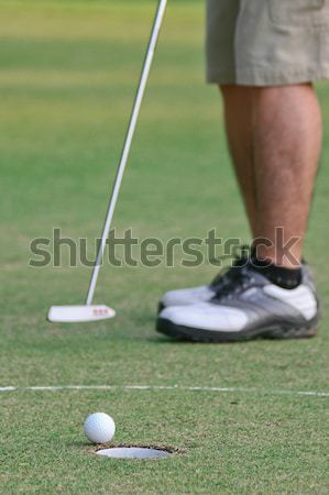 Golf putting by a man Stock photo © pinkblue