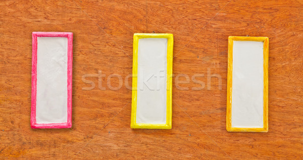 Colorful photo frame on wood wall Stock photo © pinkblue
