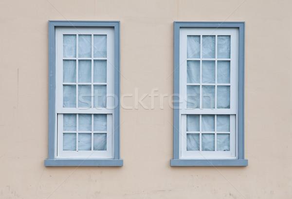 Blue windows on a wall Stock photo © pinkblue