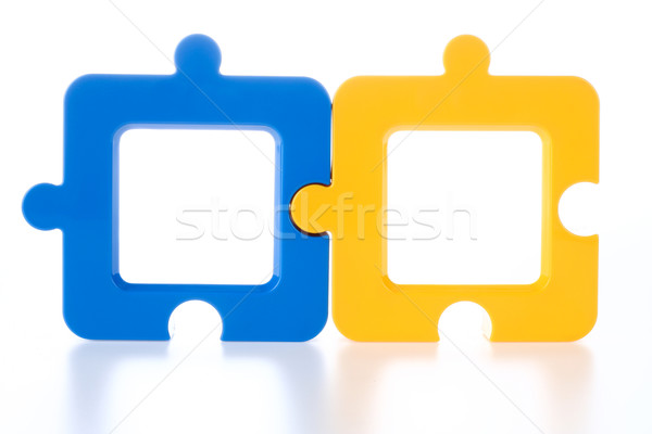 Stock photo: Couple of Jigsaw-Shape Photo Frame in Blue and Yellow