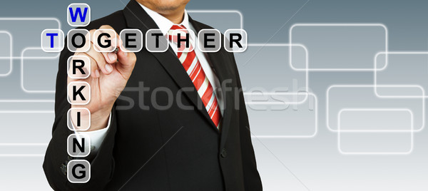 Businessman with wording Working Together Stock photo © pinkblue