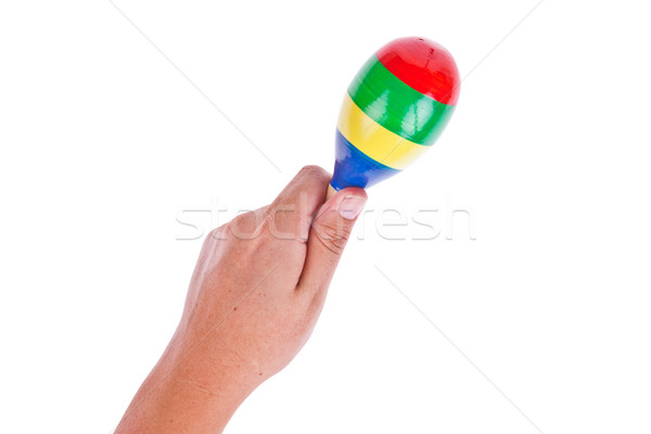 Colorful wooden maracas with hand isolated on white background Stock photo © pinkblue