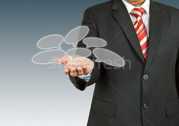 Businessman with speech balloon on his hand Stock photo © pinkblue