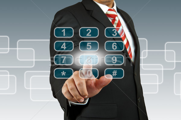 businessman hand pushing number pad screen Stock photo © pinkblue