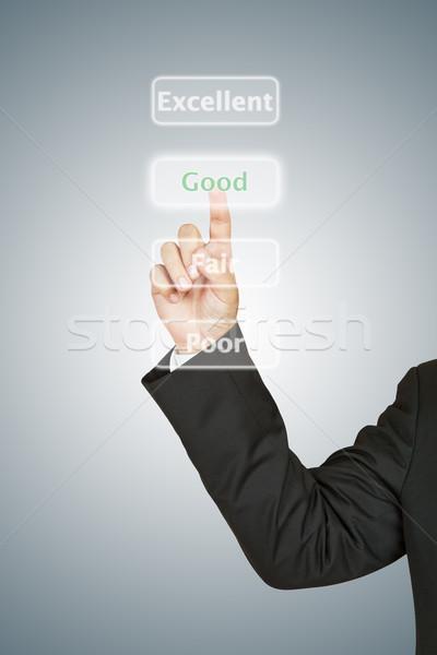 Businessman push Good button Stock photo © pinkblue