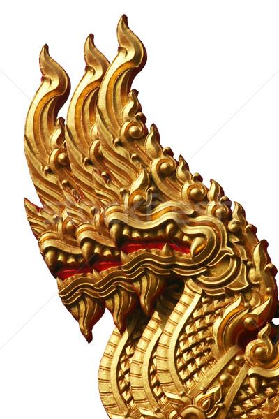 Isolated Golden Triple Naga in Thai Temple Stock photo © pinkblue