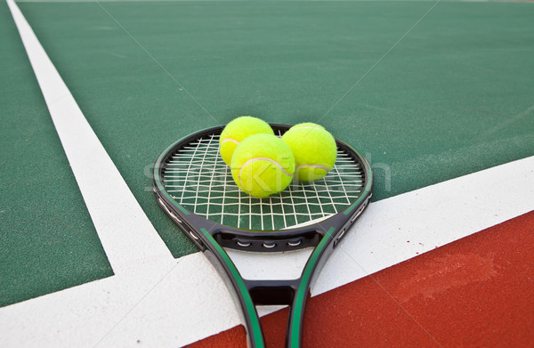Tennis court with balls and racket Stock photo © pinkblue