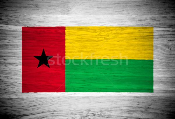 Guinea Bissau flag on wood texture Stock photo © pinkblue