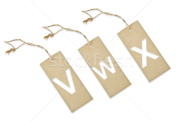 Brown paper tag with letter V W X cut Stock photo © pinkblue