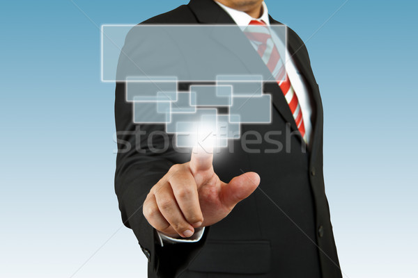businessman hand pushing screen on white background Stock photo © pinkblue