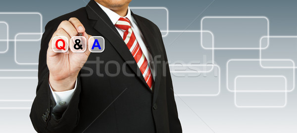 Businessman hand drawing Q&A Stock photo © pinkblue