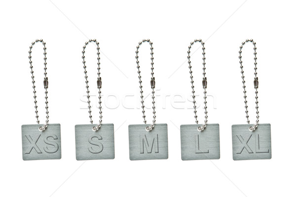 Set of silver metal tag with cloth size sign Stock photo © pinkblue