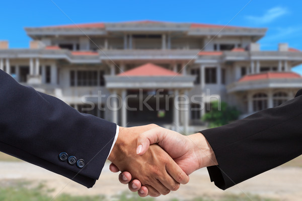 Businessman handshake for real estate business Stock photo © pinkblue