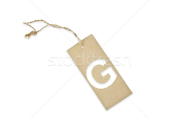 Stock photo: Brown paper tag with letter G cut