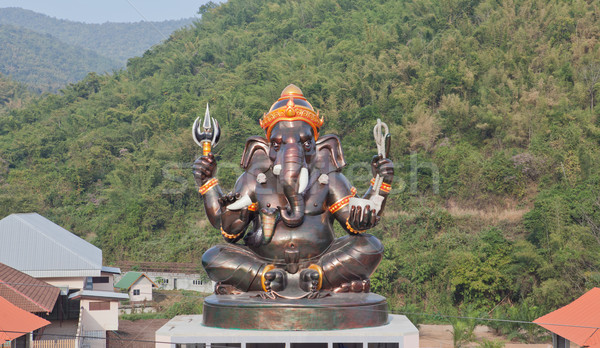 Giant Hindu God Ganesh on top of the building in a temple in Tha Stock photo © pinkblue