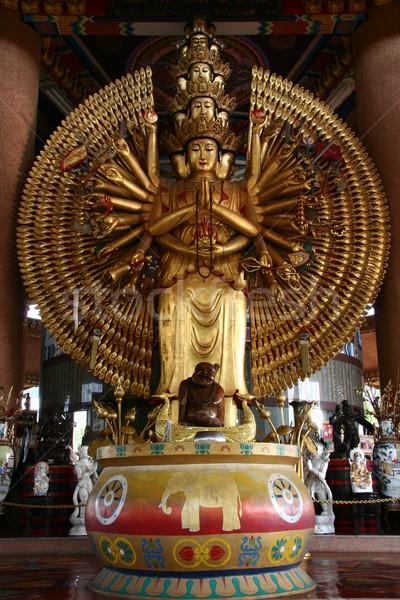 Altın bin eller Asya barış heykel Stok fotoğraf © pinkblue