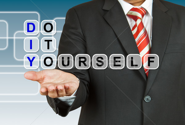 Businessman with wording Do It Yourself Stock photo © pinkblue