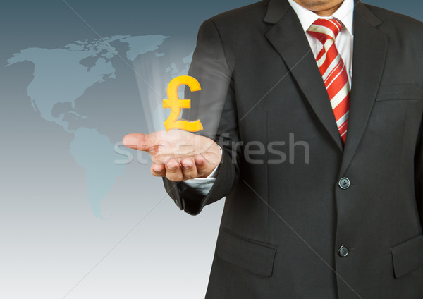 Businessman with pound symbol over his hand Stock photo © pinkblue