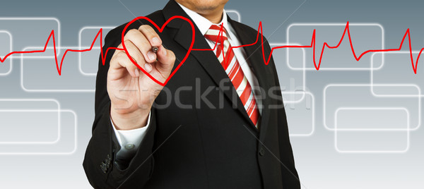 Businessman draw a pulse line with heart Stock photo © pinkblue