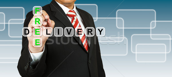 Stock photo: Businessman with wording Free Delivery