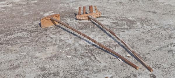 Fából készült ásó gereblye föld épület építkezés Stock fotó © pinkblue