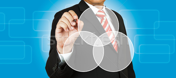 Businessman drawing intersected circle diagram Stock photo © pinkblue