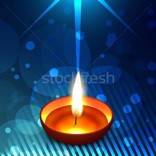 Glowing  diwali diya on a  background Stock photo © Pinnacleanimates
