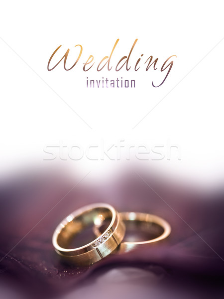 Stock photo: Gold wedding rings on a big brown leaf