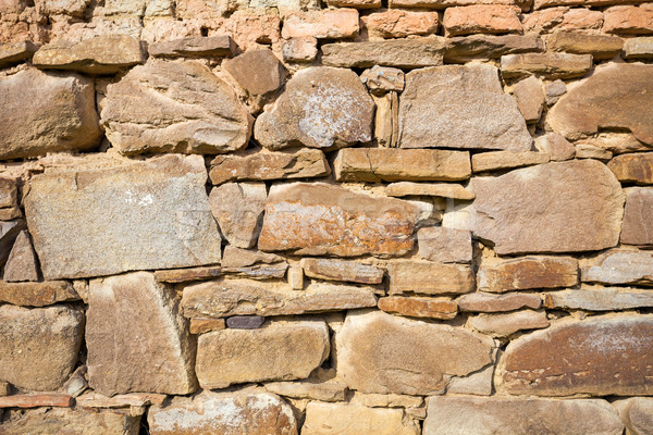 Rustic wall with layers of different shapes of rough sandstones Stock photo © pixachi
