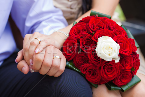Stock photo: Bride and groom holding hands