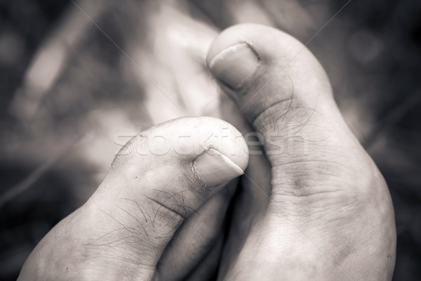 Big man barefoot close-up thumbs Stock photo © pixachi