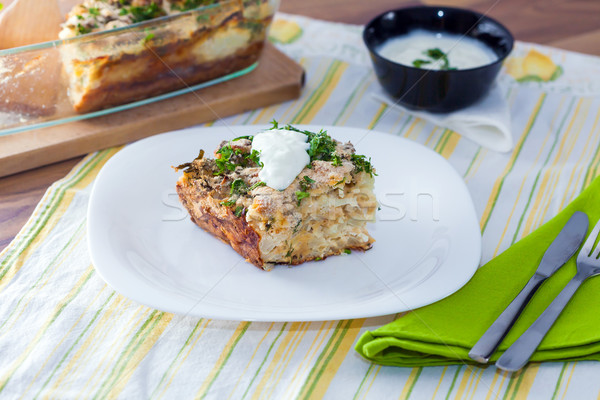 Cauliflower baked with eggs, cheese and dill on top Stock photo © pixachi
