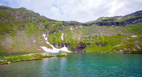 Idyllic view of Balea Lake shore in Fagaras Mountains Stock photo © pixachi