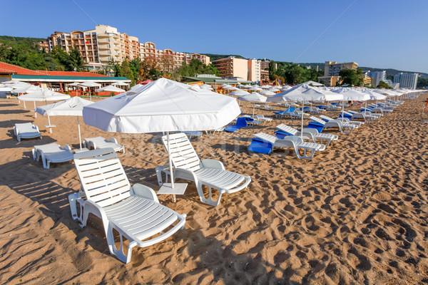 Soleil parapluies plage mer nature paysage Photo stock © pixachi